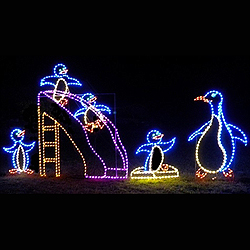 penguin on slide with momma animated led lighted outdoor christmas decoration